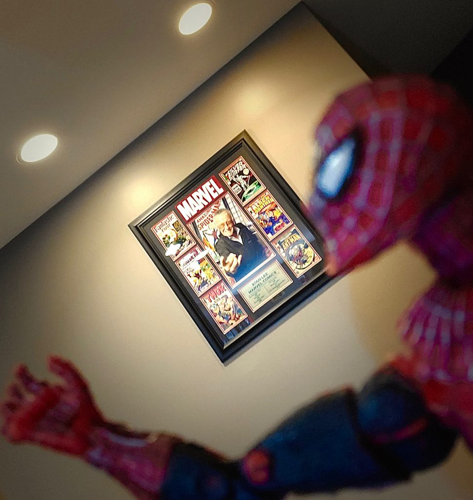 Spider-Man salutes his maker, Stan Lee.