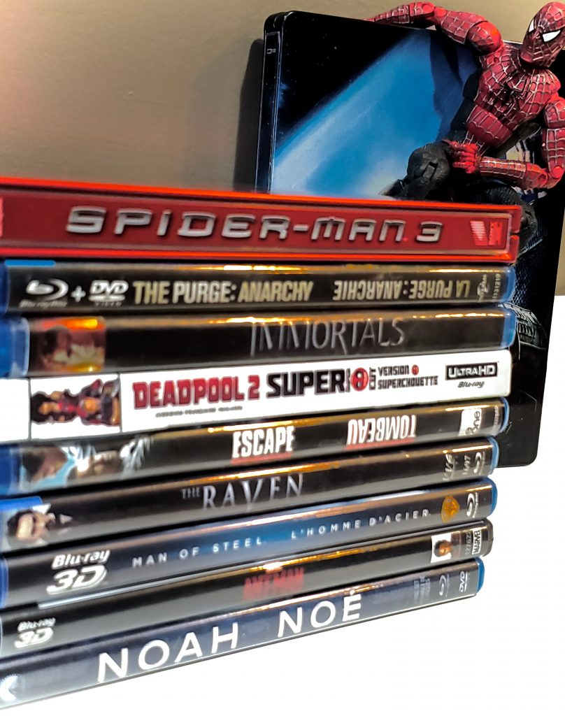 bluray collection with Spider-Man in the background